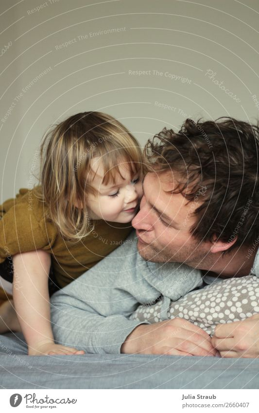 Little girl gives her daddy a kiss House (Residential Structure) Bed Bedroom Masculine Feminine Man Adults Father Family & Relations Infancy Life 2 Human being