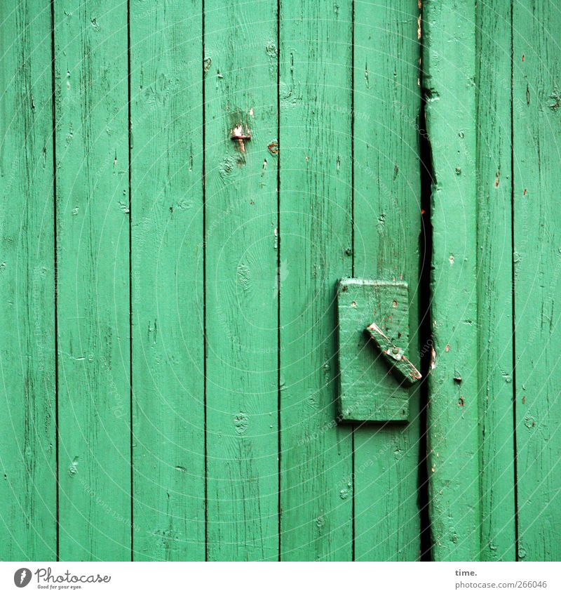 crafted Locking mechanism Closure Hut Door Wood Dirty Simple Green Uniqueness Precision Calm Moody Decline Change Farm Agriculture Barn Colour photo