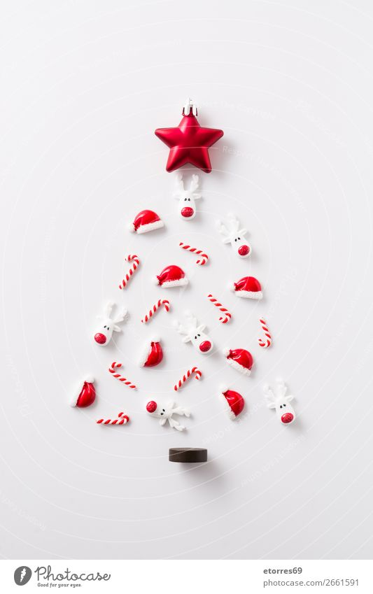 Christmas tree made with Christmas ornaments Santa Claus hat Christmas & Advent Ornament Pattern Red background Seasons Holiday season Vacation & Travel