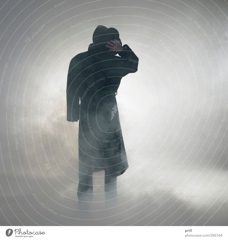 Woman wearing trench coat and standing in fog Exotic Human being Fog Coat Hat Smoke Observe Stand Wait Simple Anticipation Trust Serene Loneliness Mistrust