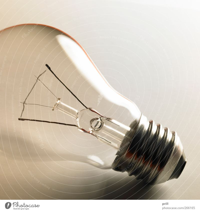 Lamp Glittering Lie Electricity Living or residing Illuminate Symbols and metaphors Simple Idea Transparent Curve Wire Electric bulb Smoothness Equipment