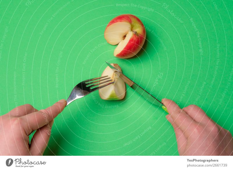 Cutting apple on a green table. Diet food. Fruit Apple Eating Vegetarian diet Cutlery Lifestyle Healthy Eating Table Kitchen Fresh Green above view apple fruit