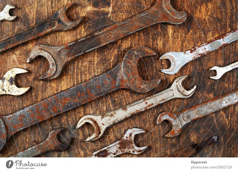 Metal bunch wrench rusty iron metal tools Table Work and employment Business Rope Man Adults Collection Wood Steel Rust Old Authentic Brown Antique background