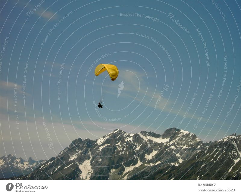 freedom Air Dream Paragliding Mountain Peak Clouds Yellow Snow Sports Joy paraglider Freedom Human being high in the sky Sky