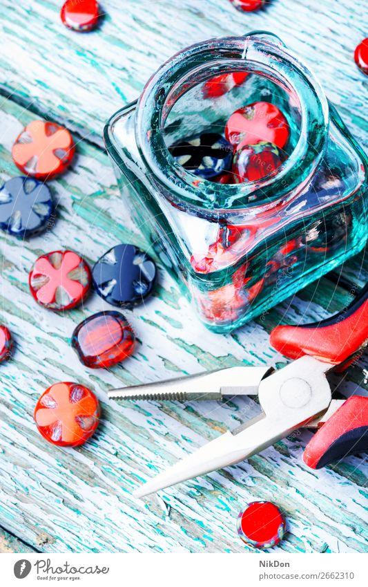 Making necklaces of glass beads. decoration craft handmade accessory beading fashion colorful Czech glass design macro stone hobby art style bracelet jewelry