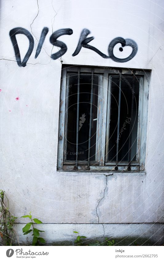 dive Deserted Wall (barrier) Wall (building) Facade Window Grating Concrete Characters Graffiti Threat Dark Hideous Cold Disco Black Gray Gloomy Colour photo