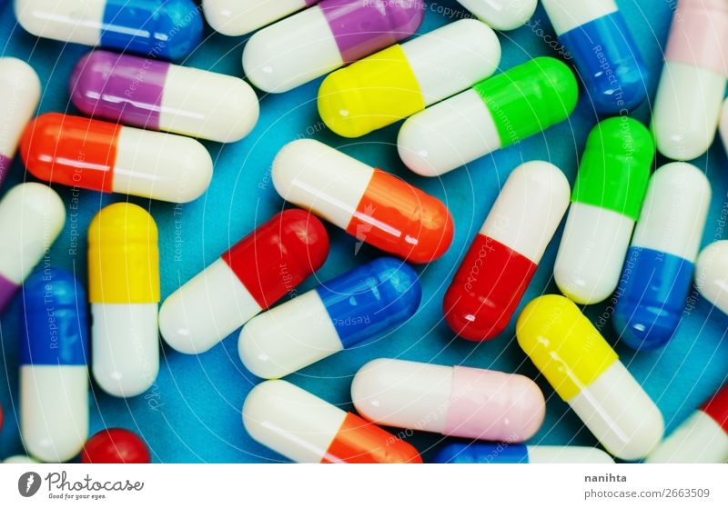 A detailed macro of pills and capsules Colour Healthy Health care Small Design Bright Simple Help Illness Depth of field Medication Pain Material Intoxicant
