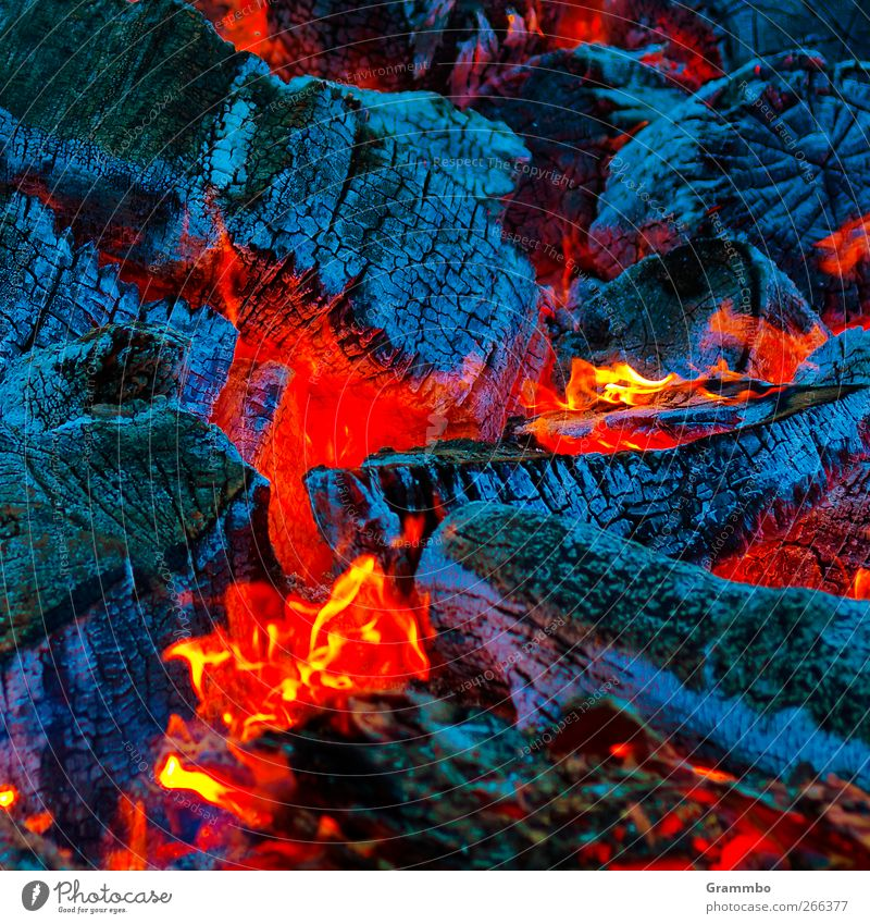 Easter fire core Fire Burn Embers Red Blue Illuminate Bright Colours Flame Warmth Fireplace Camp fire atmosphere Colour photo Exterior shot Close-up