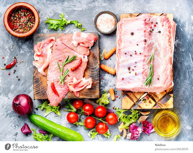 Raw beef meat raw food steak fresh cut red chop uncooked butcher fork spice rosemary pepper fillet herb protein slice sirloin meal seasoning beefsteak veal