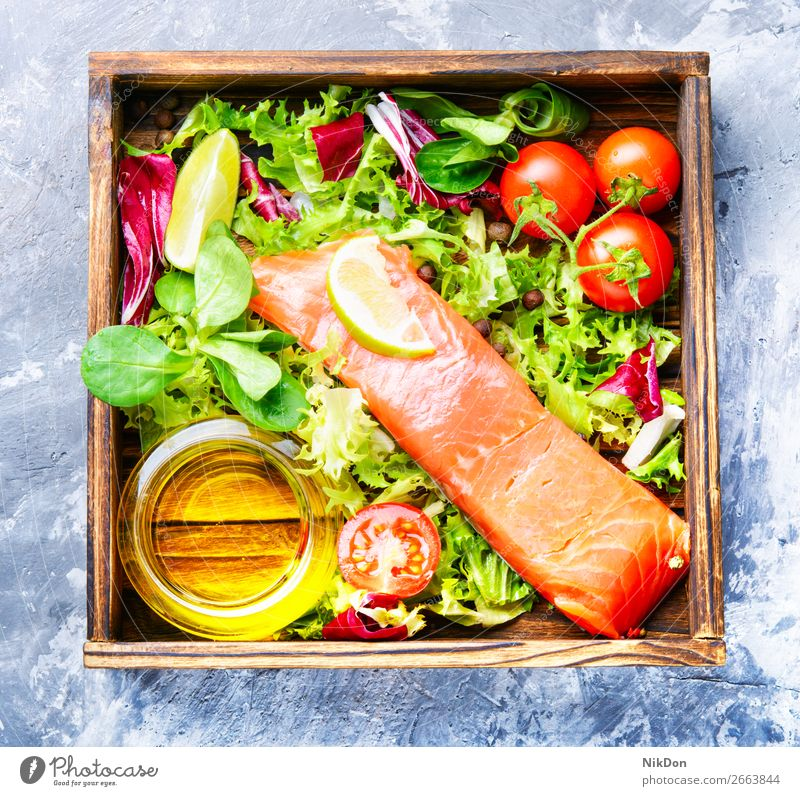 Salted salmon fillet with aromatic herbs seafood fish box dinner natural salt diet slice tomato trout lettuce piece lemon salted green meat dieting salty