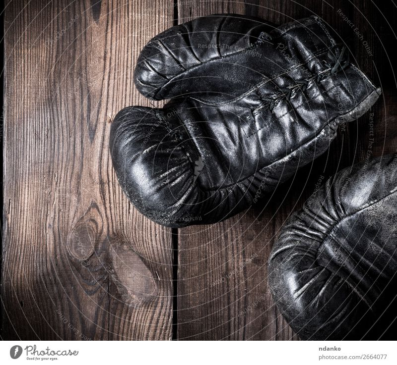 pair of old leather boxing gloves Fitness Sports Leather Gloves Wood Old Retro Brown Black Protection Competition Action Ancient Antique background boxer Boxing