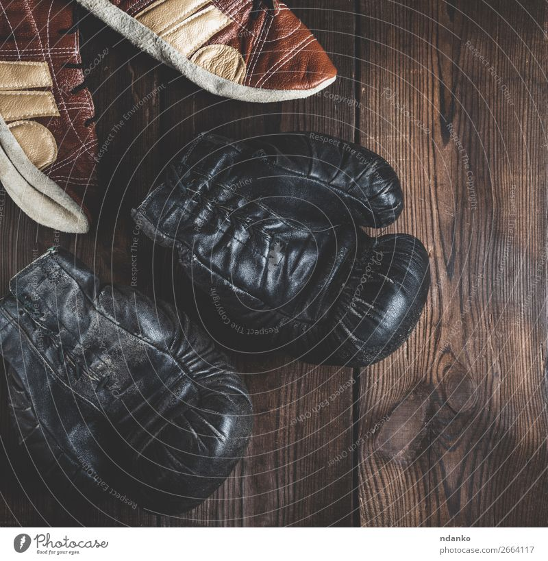 pair of very old leather black boxing gloves Lifestyle Fitness Sports Success Leather Gloves Footwear Wood Old Dark Retro Brown Black Protection Competition