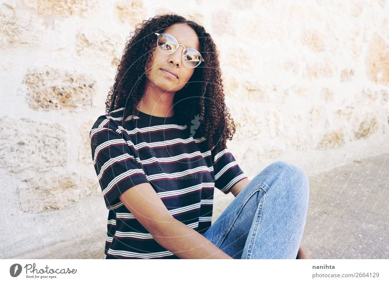 A portrait of serious young nerdy woman Woman Human being Youth (Young adults) Young woman Beautiful Calm Black 18 - 30 years Lifestyle Adults Feminine Style