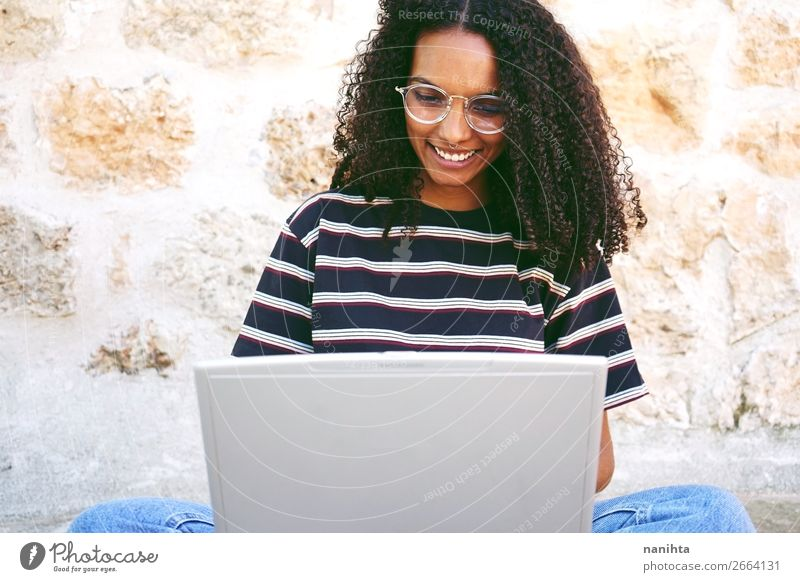 smiling young woman working with her laptop Lifestyle Style Happy Beautiful Hair and hairstyles Calm Education Adult Education Study Student Work and employment