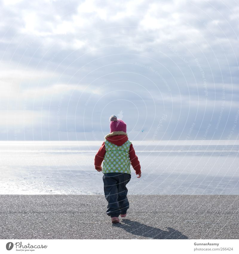Human being Child Blue Red Ocean Girl Joy Clouds Feminine Autumn Spring Coast Small Body Infancy Walking