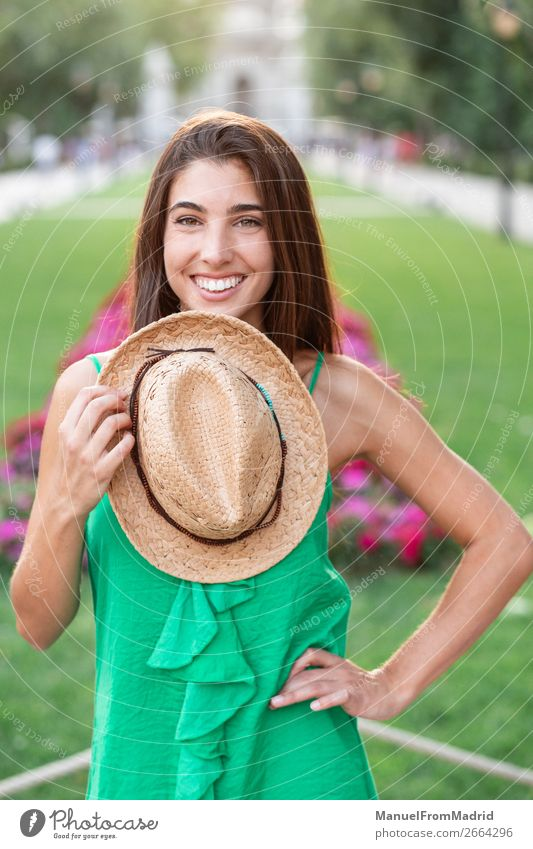 Portrait of a young happy woman in the park Lifestyle Happy Beautiful Vacation & Travel Tourism Summer Human being Woman Adults Nature Park Street Fashion Hat