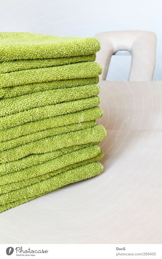 towels are well prepared on a pillow - patients welcome Towel Stack Green Wellness Physiotherapy Section of image Partially visible Central perspective Deserted