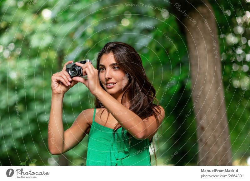 young beautiful tourist woman using a photo camera Lifestyle Happy Beautiful Vacation & Travel Tourism Summer Camera Human being Woman Adults Tree Park Street