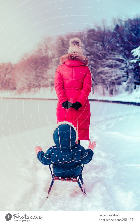 Mother and her daughter are spending time together in winter Lifestyle Joy Happy Winter Snow Winter vacation Human being Child Toddler Girl Young woman