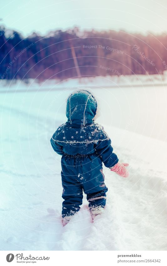 Little girl enjoying winter walking through deep snow Lifestyle Joy Happy Winter Snow Winter vacation Child Baby Toddler Girl Infancy 1 Human being 3 - 8 years