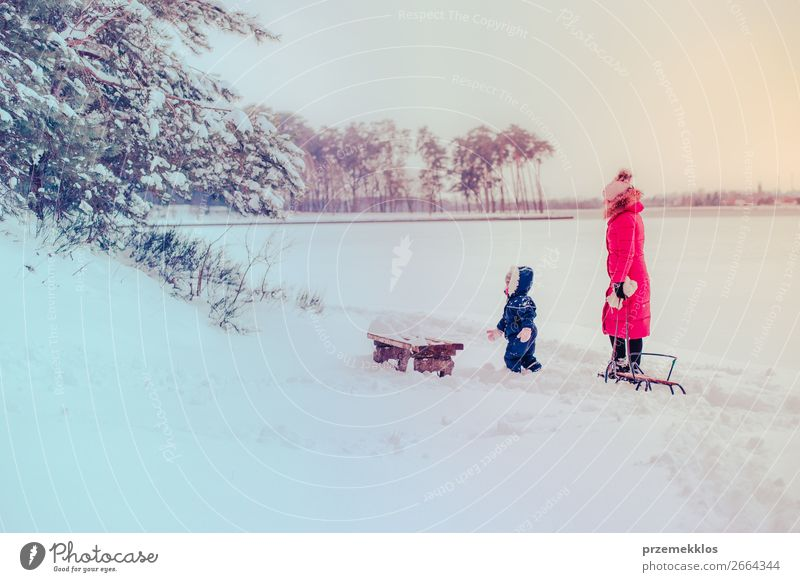 Mother and her daughter walking outdoors in winter Woman Child Human being Nature Youth (Young adults) Young woman White Landscape Joy Forest Winter Girl
