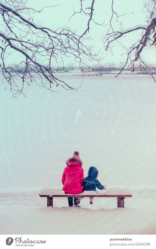 Mother and her daughter sitting on a bench on wintery day Lifestyle Joy Happy Winter Snow Winter vacation Human being Child Toddler Girl Young woman