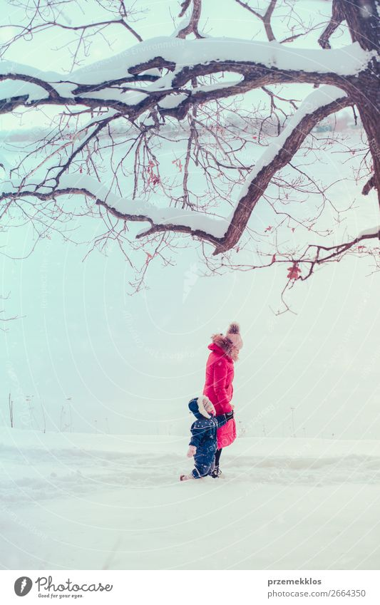 Mother and her daughter are spending time outdoors in winter Lifestyle Joy Happy Winter Snow Winter vacation Human being Child Toddler Girl Young woman