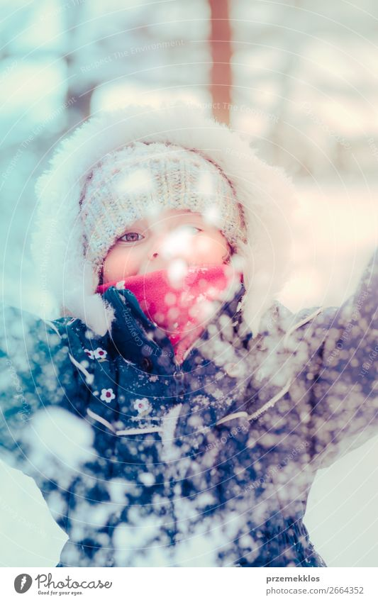 Little girl enjoying the snow on cold wintery day Child Human being Nature White Joy Winter Girl Lifestyle Cold Natural Funny Snow Happy Small Together Snowfall