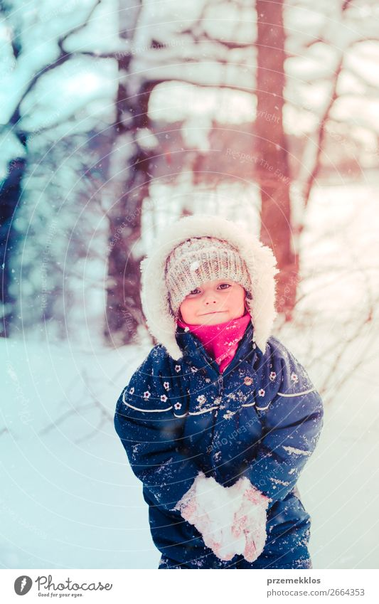 Little girl enjoying the snow on cold wintery day Child Human being Nature White Joy Forest Winter Girl Lifestyle Snow Happy Small Together Snowfall Park