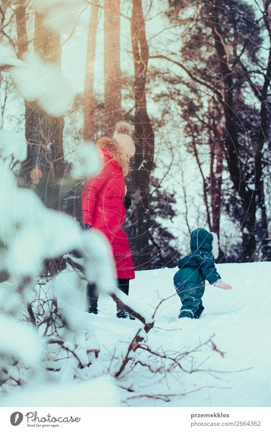 Family spending time together walking outdoors in winter Lifestyle Joy Happy Winter Snow Winter vacation Human being Child Toddler Girl Young woman