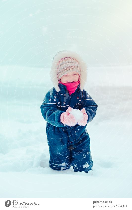 Happy little girl enjoying snow in wintertime while snow falling Lifestyle Joy Winter Snow Winter vacation Child Toddler Girl Infancy 1 Human being 3 - 8 years