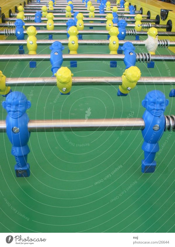 Table EM? Green Yellow Table soccer World Cup Photographic technology Blue Central perspective Blue-yellow Rod Many Row Side by side Behind one another