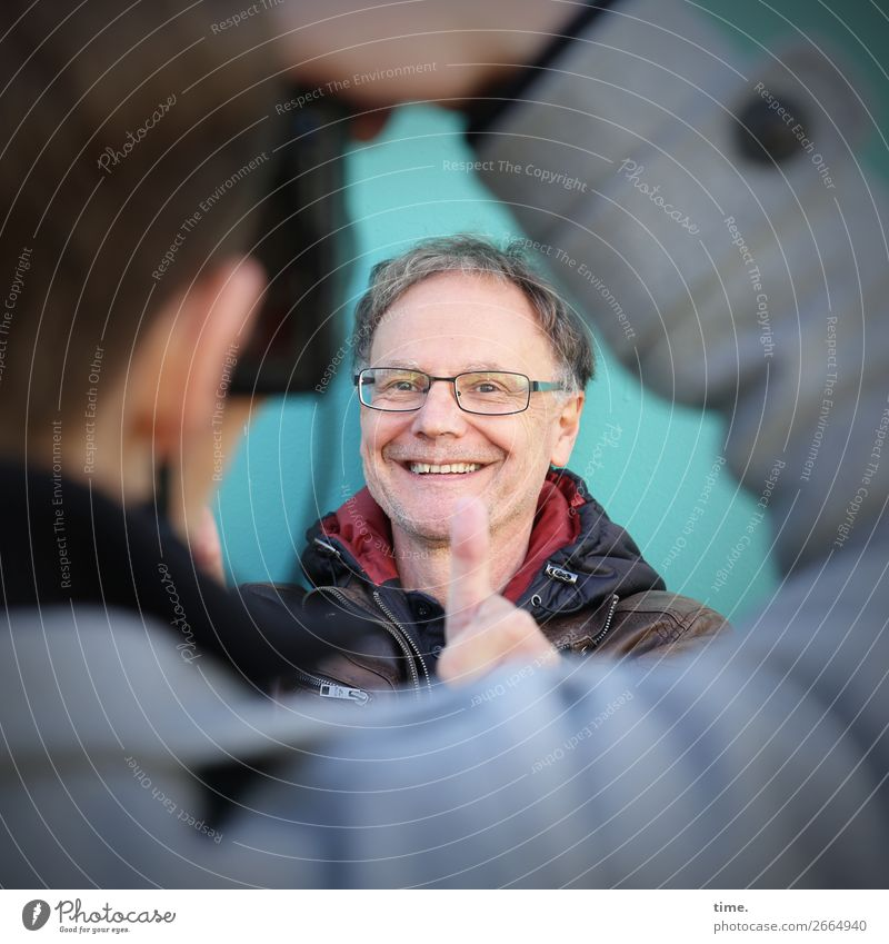 flip book Camera Masculine Man Adults 2 Human being Wall (barrier) Wall (building) Jacket Eyeglasses brunette Short-haired Thumb smile Laughter Joy Contentment