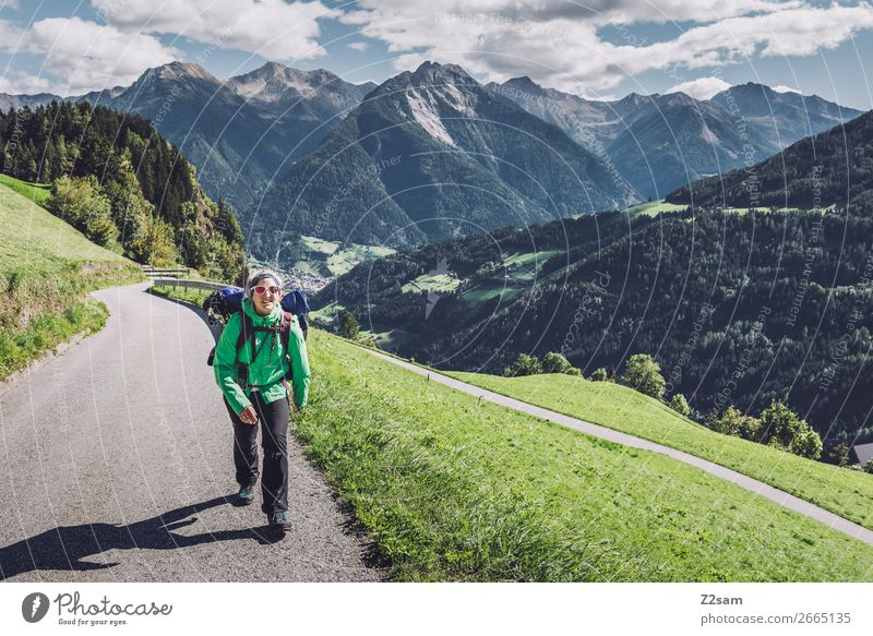 Young woman crossing the Alps Vacation & Travel Mountain Hiking Climbing Mountaineering Youth (Young adults) 30 - 45 years Adults Nature Landscape Sky