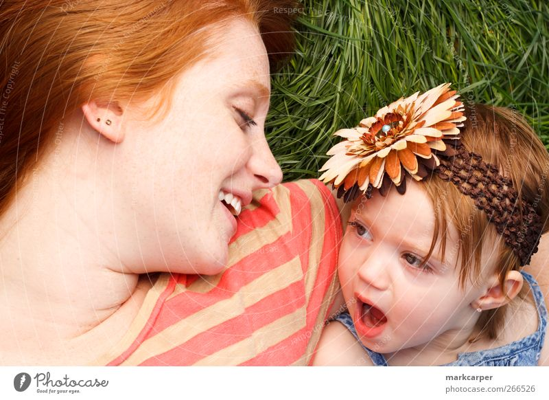 Smiling Mother And Daughter Laying In Tall Grass Joy Happy Child Toddler Girl Adults Red-haired Green parenthood motherhood mommy's girl red hair laying kid