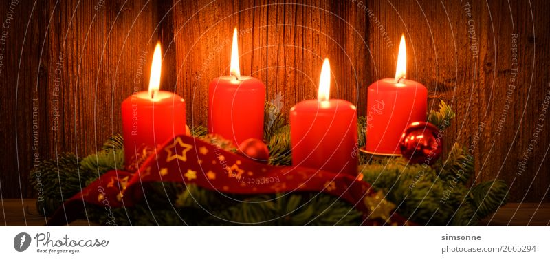 Christmas Advent wreath with 4 burning candles on old wood Decoration Christmas & Advent Candle Wood Flag Long Soft Red Moody Romance Christmas wreath