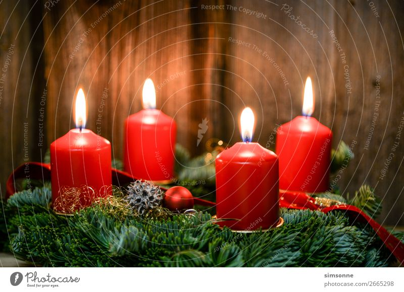 Christmas Advent wreath with 4 burning candles on old wood Decoration Christmas & Advent Candle Wood Flag Soft Red Moody Romance Christmas wreath Candlelight