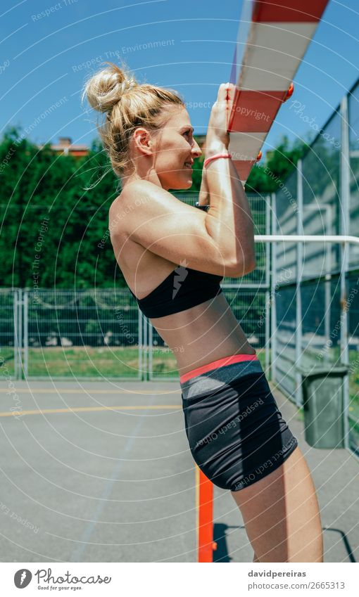 Female athlete doing pull-ups in a goal Woman Human being Summer Beautiful Lifestyle Adults Sports Body Blonde Power Action Authentic Fitness Energy Athletic