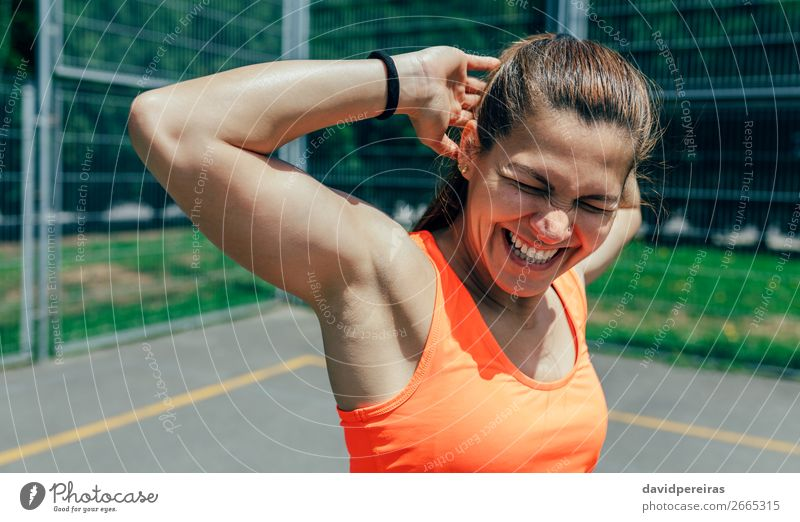 Sportswoman doing arm stretches Lifestyle Joy Happy Personal hygiene Body Summer Human being Woman Adults Fitness Laughter Athletic Authentic Strong arms up
