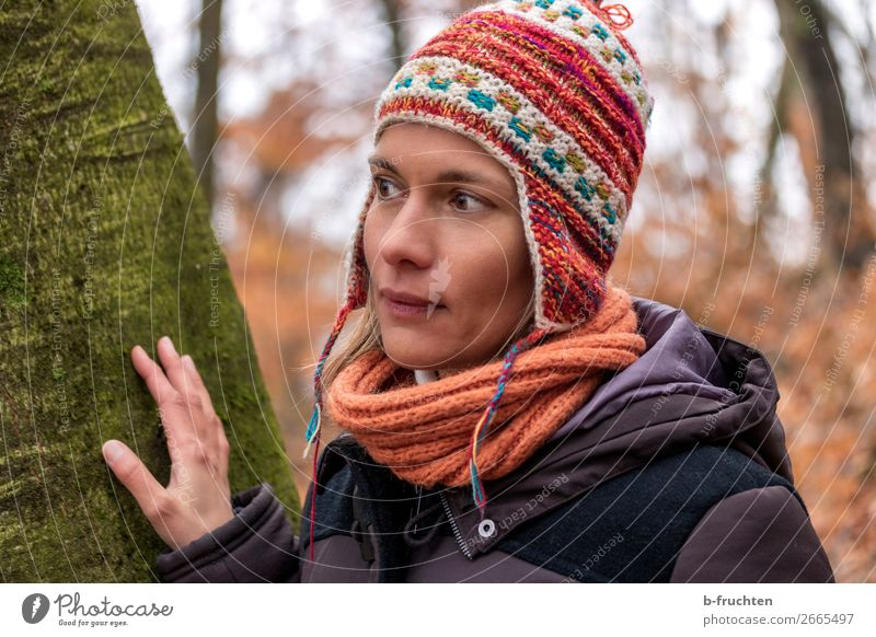 Woman with Peruvian cap Harmonious Contentment Hiking Adults Face Hand Autumn Tree Park Forest Coat Scarf Cap Observe Relaxation Looking Stand Simple Beautiful