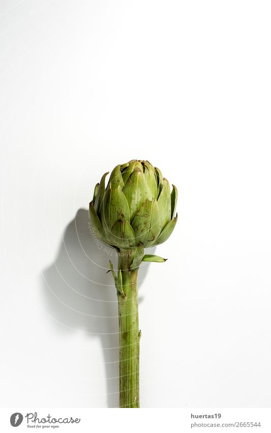 Fresh raw artichokes. On white background. Food Vegetable Nutrition Vegetarian diet Diet Healthy Eating Natural Above Green White Artichoke Raw Detox healthy