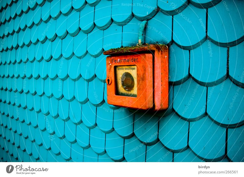 Is there a fire? Wall (barrier) Wall (building) Facade Fire alarm Illuminate Esthetic Exceptional Long Original Positive Blue Red Safety Protection Colour