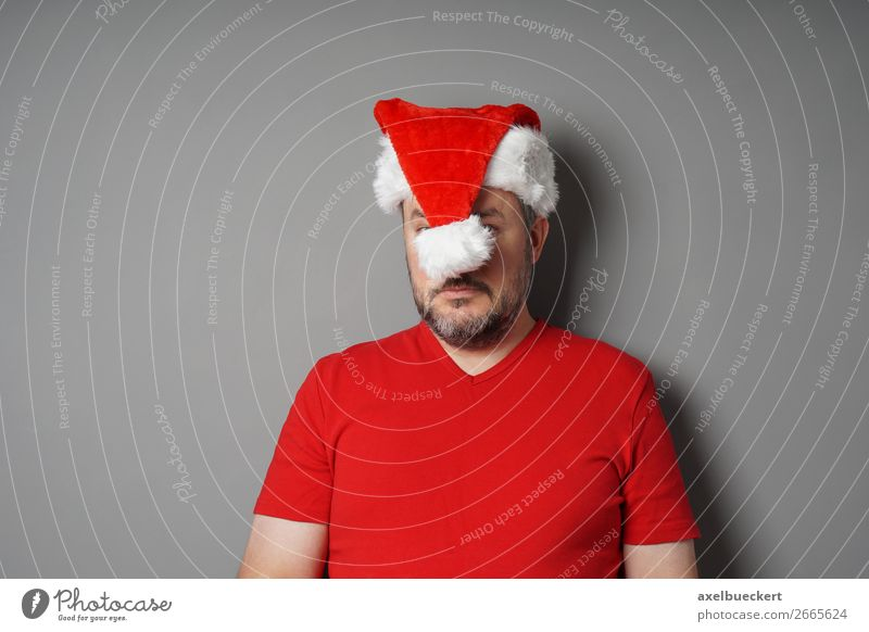 Human being Man Christmas & Advent Winter Adults Sadness Funny Feasts & Celebrations Masculine 45 - 60 years T-shirt Stress Facial hair Cap Hide Santa Claus