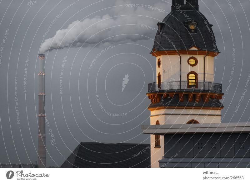 Tower of historic town hall with smoking chimney in the background City hall Manmade structures Building Window Roof Chimney Environmental pollution Flare Smoke