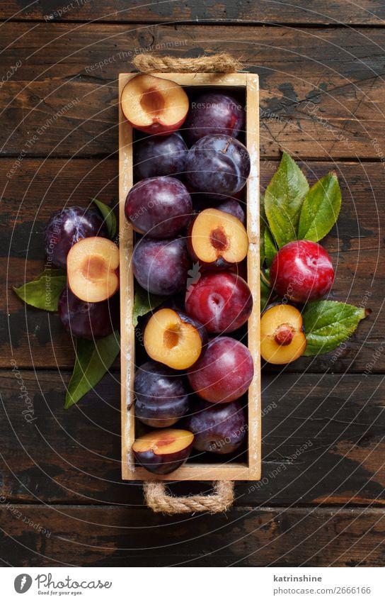 Fresh plums with leaves Fruit Nutrition Vegetarian diet Diet Bowl Summer Table Autumn Leaf Wood Juicy Brown Plum Purple Raw Mature agriculture sweet vitamins