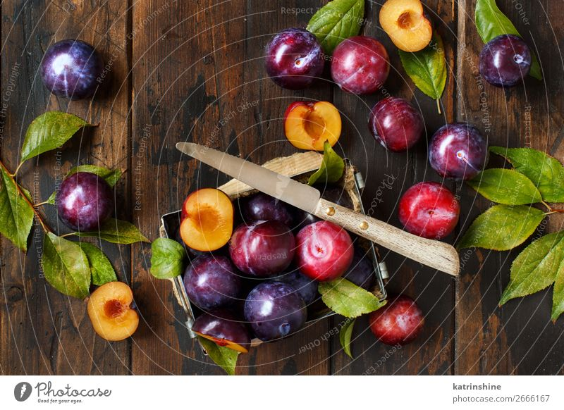 Fresh plums with leaves Fruit Nutrition Vegetarian diet Diet Summer Table Autumn Leaf Wood Juicy Brown Plum Purple Raw Mature agriculture sweet vitamins Rustic