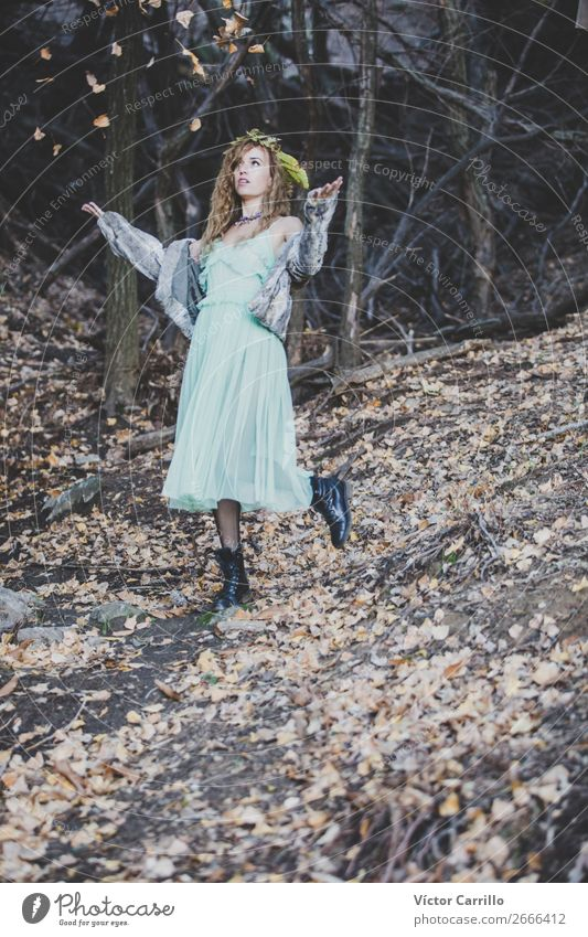 A Young Woman playing with leaves in the woods Human being Youth (Young adults) Young woman Beautiful Animal Joy 18 - 30 years Lifestyle Adults Feminine