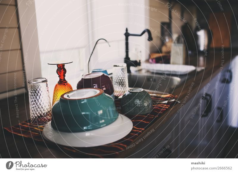 clean dishes in modern kitchen. Washing plates Plate Bowl Spoon Lifestyle House (Residential Structure) Table Kitchen Work and employment Dirty Modern Wet Clean