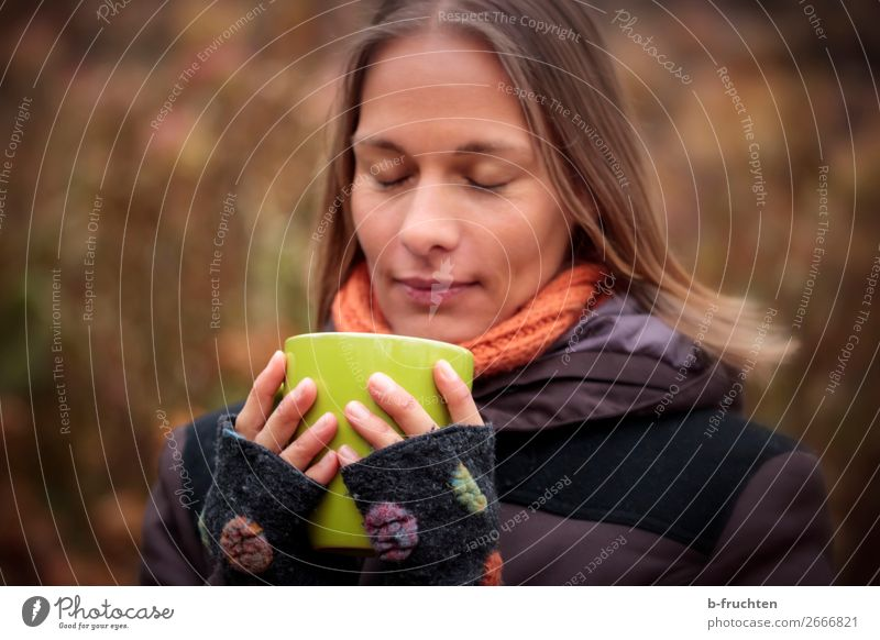 Woman with cup, outside Drinking Hot drink Coffee Tea Mulled wine Cup Mug Well-being Contentment Calm Adults Face Fingers 1 Human being Autumn Park Forest Coat