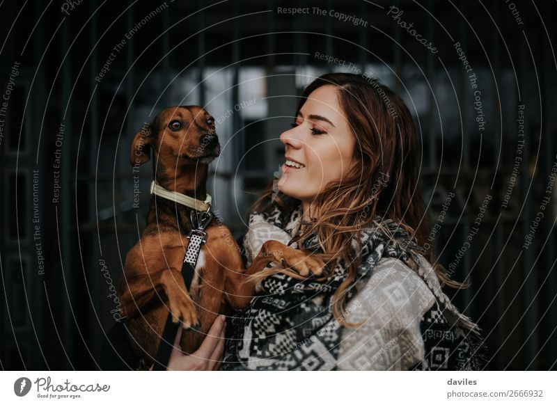 White smiling girl holing her dog in the arms Lifestyle Joy Young woman Youth (Young adults) Woman Adults Friendship 1 Human being 30 - 45 years Town Scarf